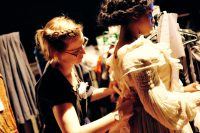 Costume student dressing a show