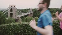 Clifton Suspension Bridge in the background with blurred joggers in the foreground