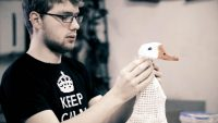 Student making a model of a goose