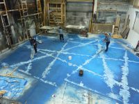 Scenic Artists working on floor for The Snow Queen