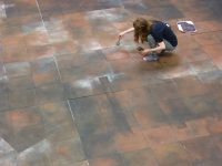 Scenic Art student painting a floor