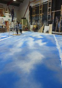 Scenic Art students creating a sky floor