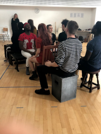 Students sat down in rehearsal