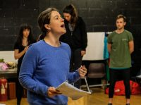 Female student holding a script in rehearsal