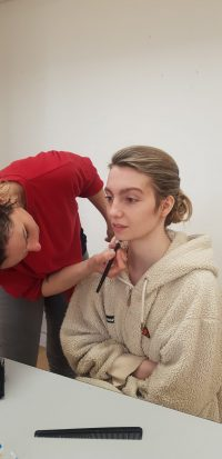 Student being made up by another student