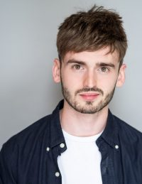 Headshot of male international MFA acting student