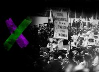 Black and white photo of suffragettes marching and carrying a banner