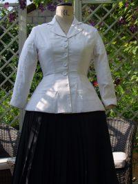 White jacket and black skirt on mannequin