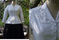 On left black skirt and white jacket on mannequin, on right close up of white jacket detail on mannequin