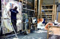 Scenic artist painting wall mural