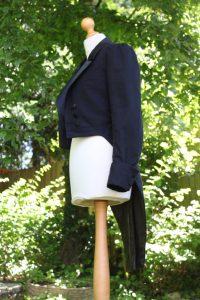 Side view of dinner jacket design on mannequin