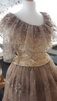 Close up of ornate sparkling dress