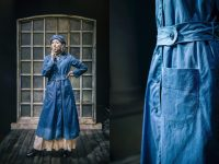 On left photo of actress wearing blue work smock and hat, smoking. On right close up of pocket and belt detail.