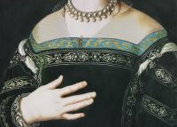 Close up of tudor lady's right hand pressed against her chest