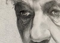 Close up black and white drawing of male eyes and nose