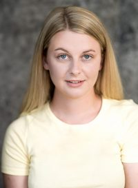 image of blonde female actress in yellow t-shirt - headshot style