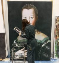 Artist stood up painting large portrait of a tudor lady
