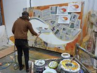 Artist paint spraying large art work of murano glass bowl