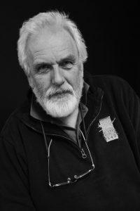 Black and white photo of alumnus John Leonard