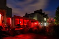 Main building with red lighting installation