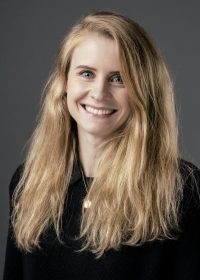 Headshot of smiling woman with long blonde hair