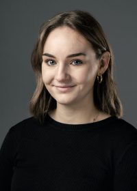 Headshot of female student with mid length brown hair