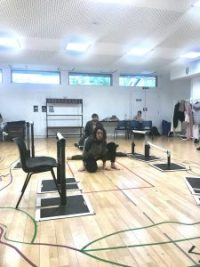 Two actors knelt on the floor in rehearsals
