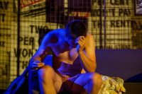Actor sat in underwear with head in hand