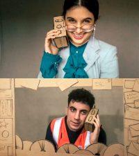 Students talking on cardboard prop mobile phones